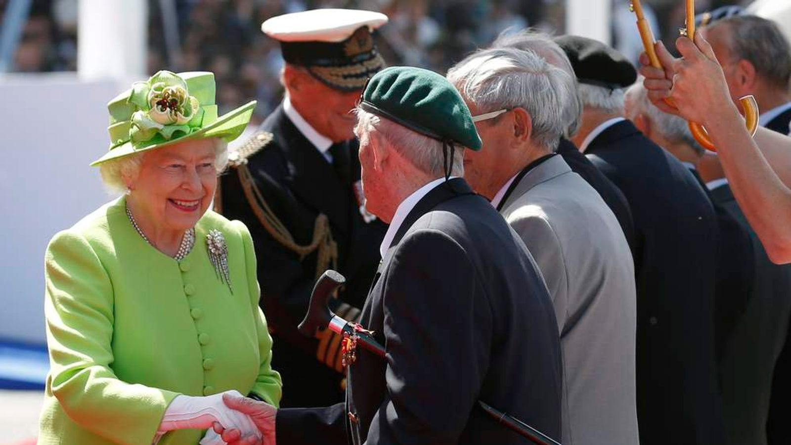 Britain's Queen Elizabeth greets a WWII veteran at the International 70th D-Day Commemoration Ceremony at Sword Beach in Ouistreham