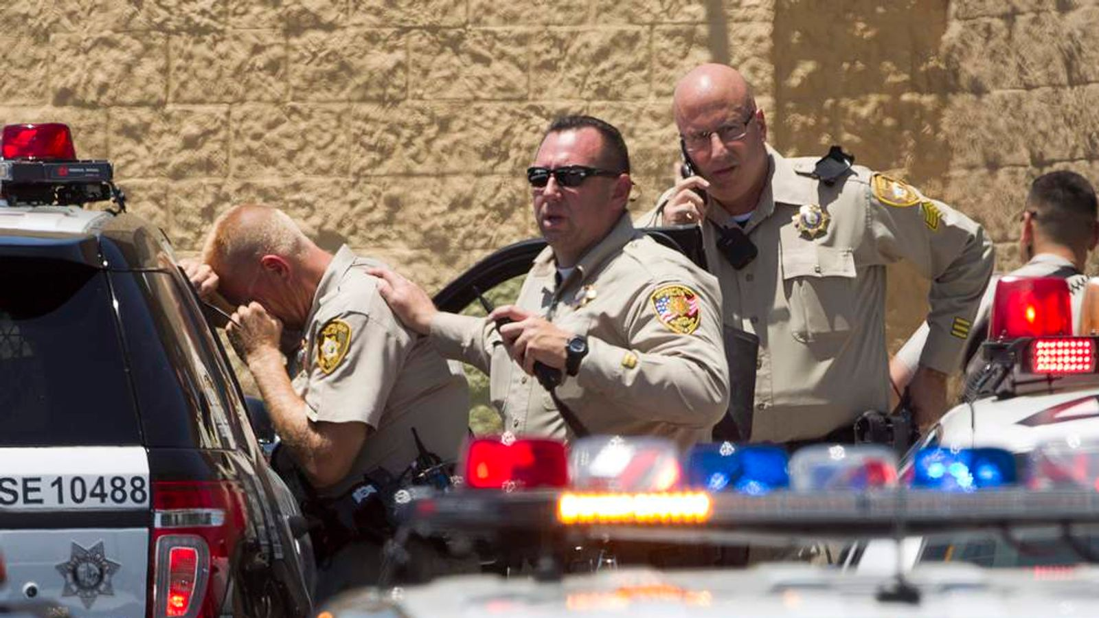 Metro Police officers are shown outside a Wal-Mart after a shooting in Las Vegas
