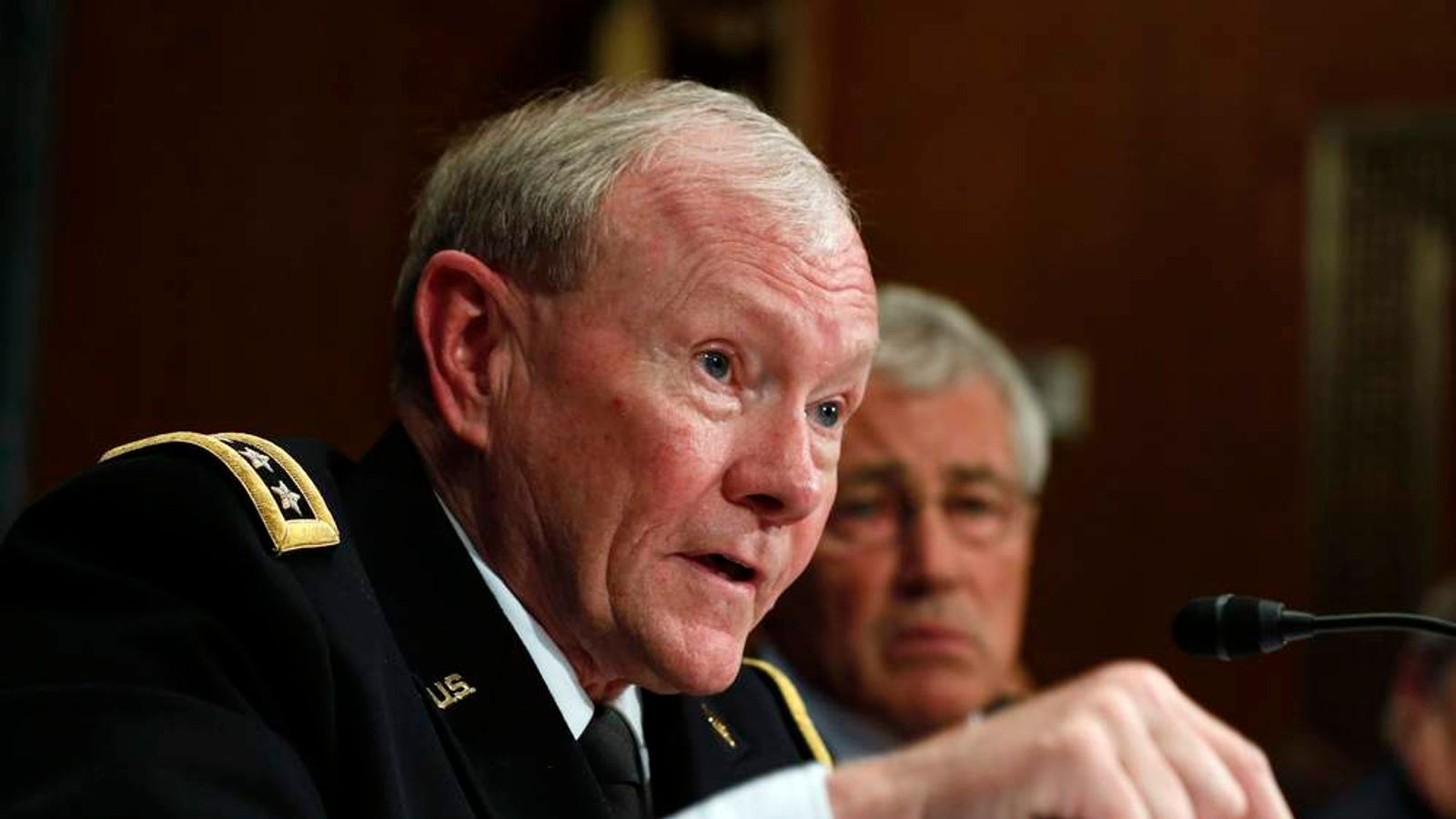 Chairman of the Joint Chiefs Gen. Dempsey speaks next to U.S. Secretary of Defense Hagel during the defense subcommittee of the Senate Appropriations Committee on Capitol Hill in Washington.