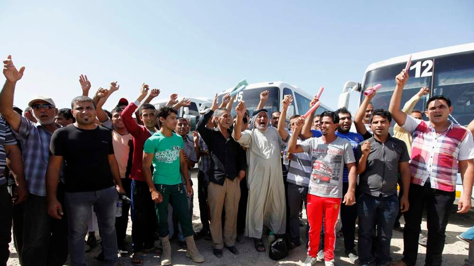 Volunteers, who have joined the Iraqi Army to fight against the predominantly Sunni militants from ISIL who have taken over Mosul and other northern provinces, chant slogans in Baghdad