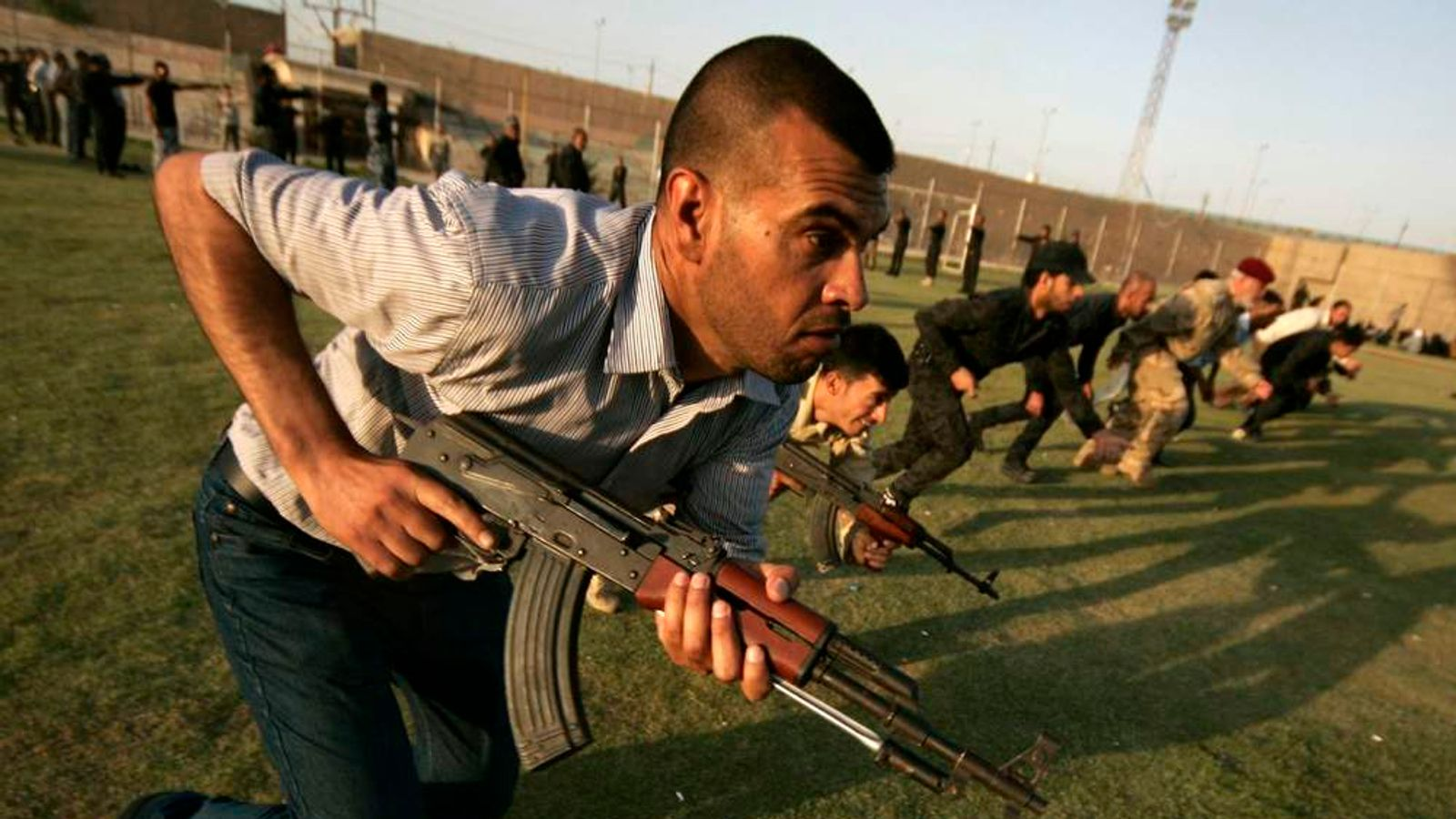 Shi'ite volunteers, who have joined the Iraqi army to fight the ISIL, take part in military-style training in Kerbala