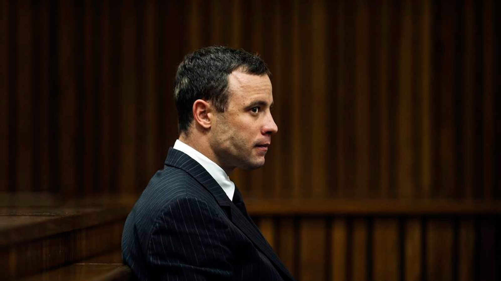 Oscar Pistorius sits in court during his trial.