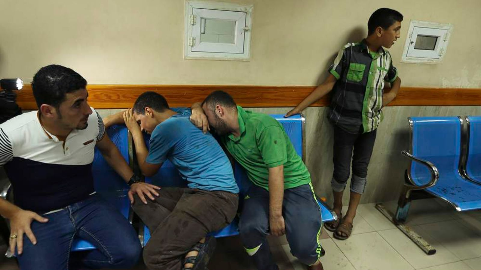 Palestinians react after their relatives were killed in what hospital officials said was an Israeli air strike in Gaza City