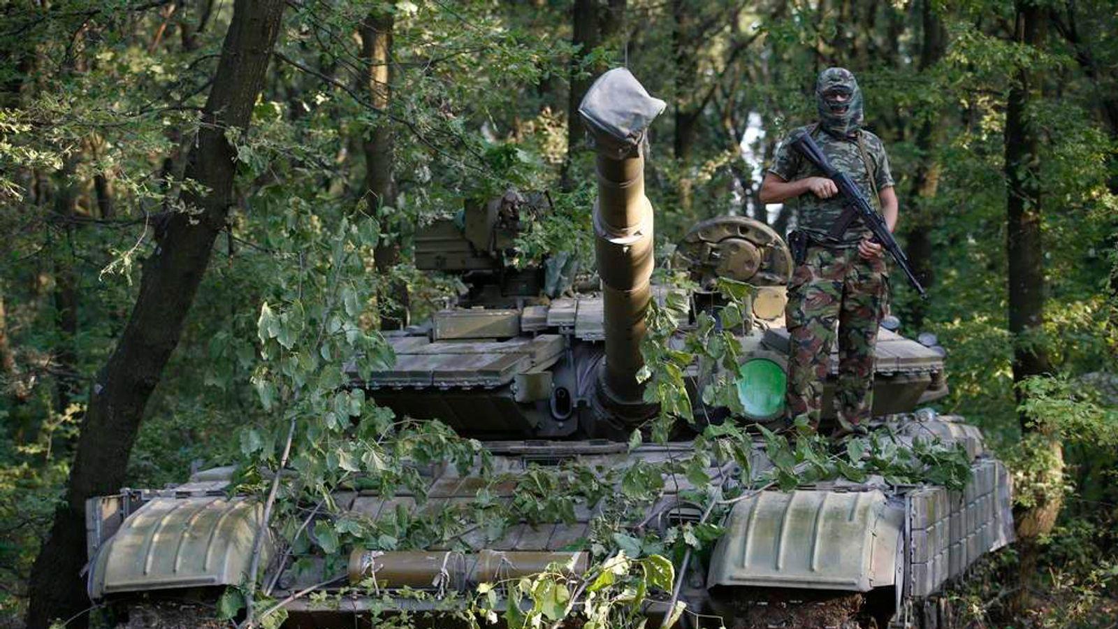Pro-Russian Rebel Fighter On Tank In Eastern Ukraine