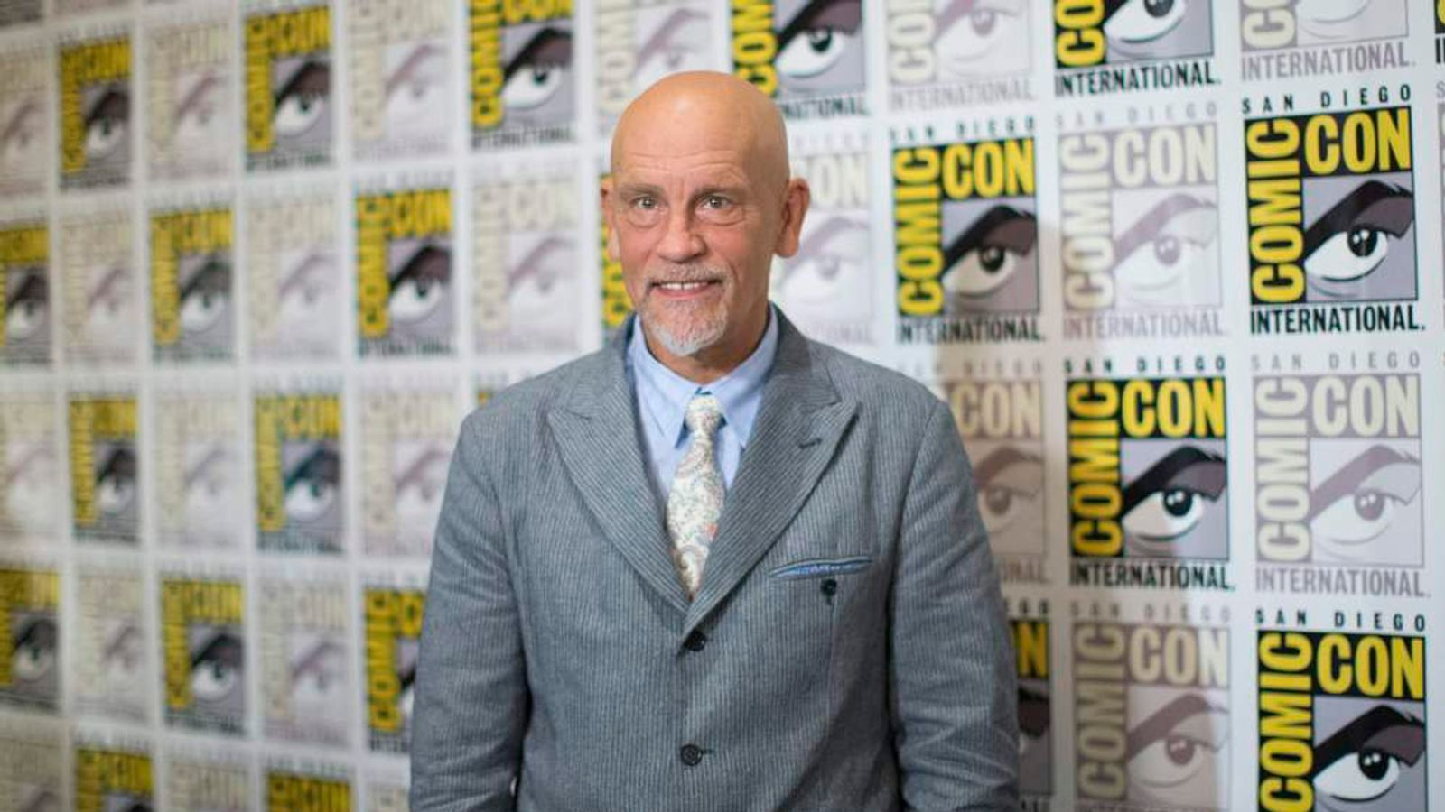 """Actor Malkovich, who voices """"Dave"""", poses at a press line for the movie """"Penguins of Madagascar"""" during the 2014 Comic-Con International Convention in San Diego"""