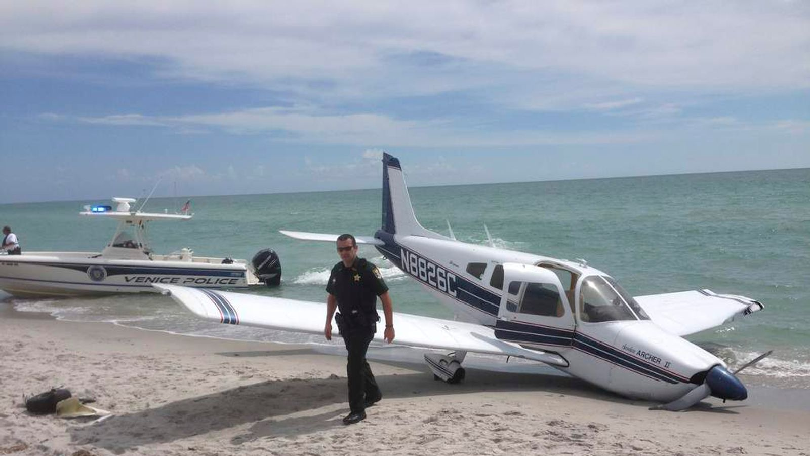 First responders at the scene of a single engine Piper Cherokee plane crash in this photo provided by the Sarasota County Sheriff's Office in Caspersen Beach in Venice.