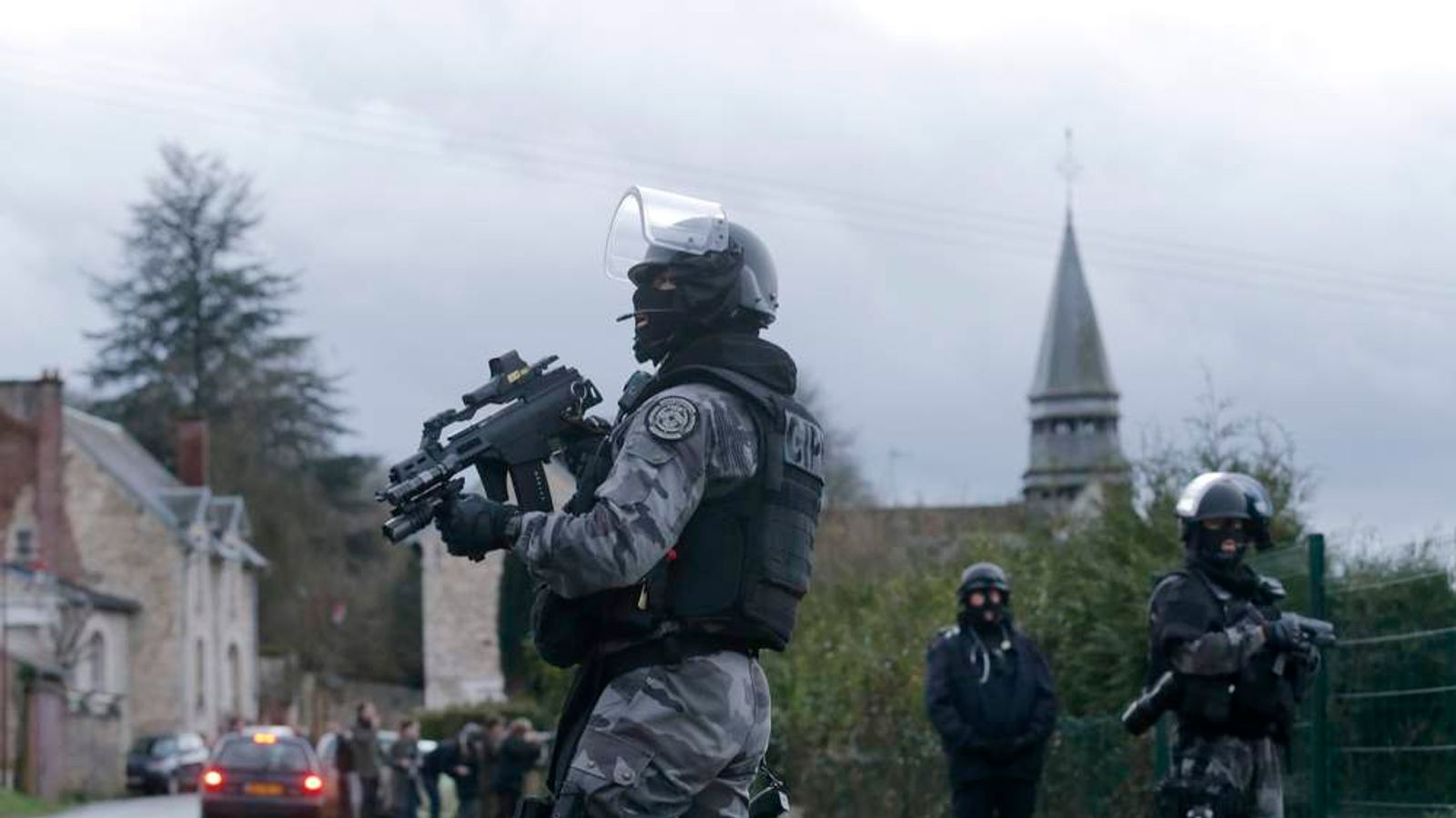 A member of the French GIPN intervention police forces secure a neighbourhood in Corcy, northeast of Paris
