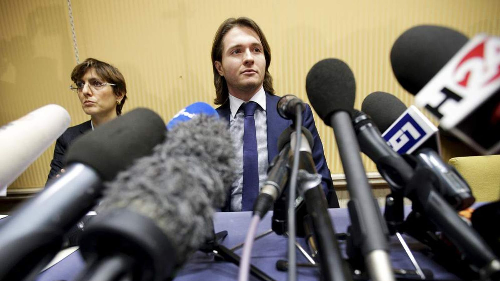 Sollecito Looks on next to his lawyer Bongiorno during a news conference in Rome