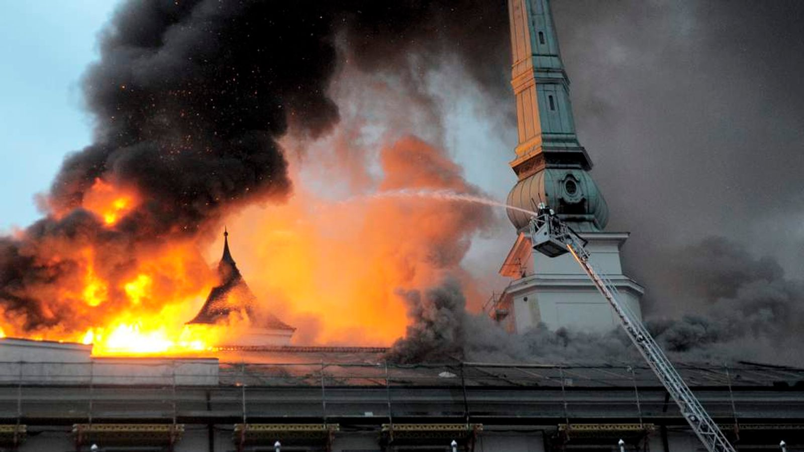 Firefighters try to douse a fire at the Riga castle