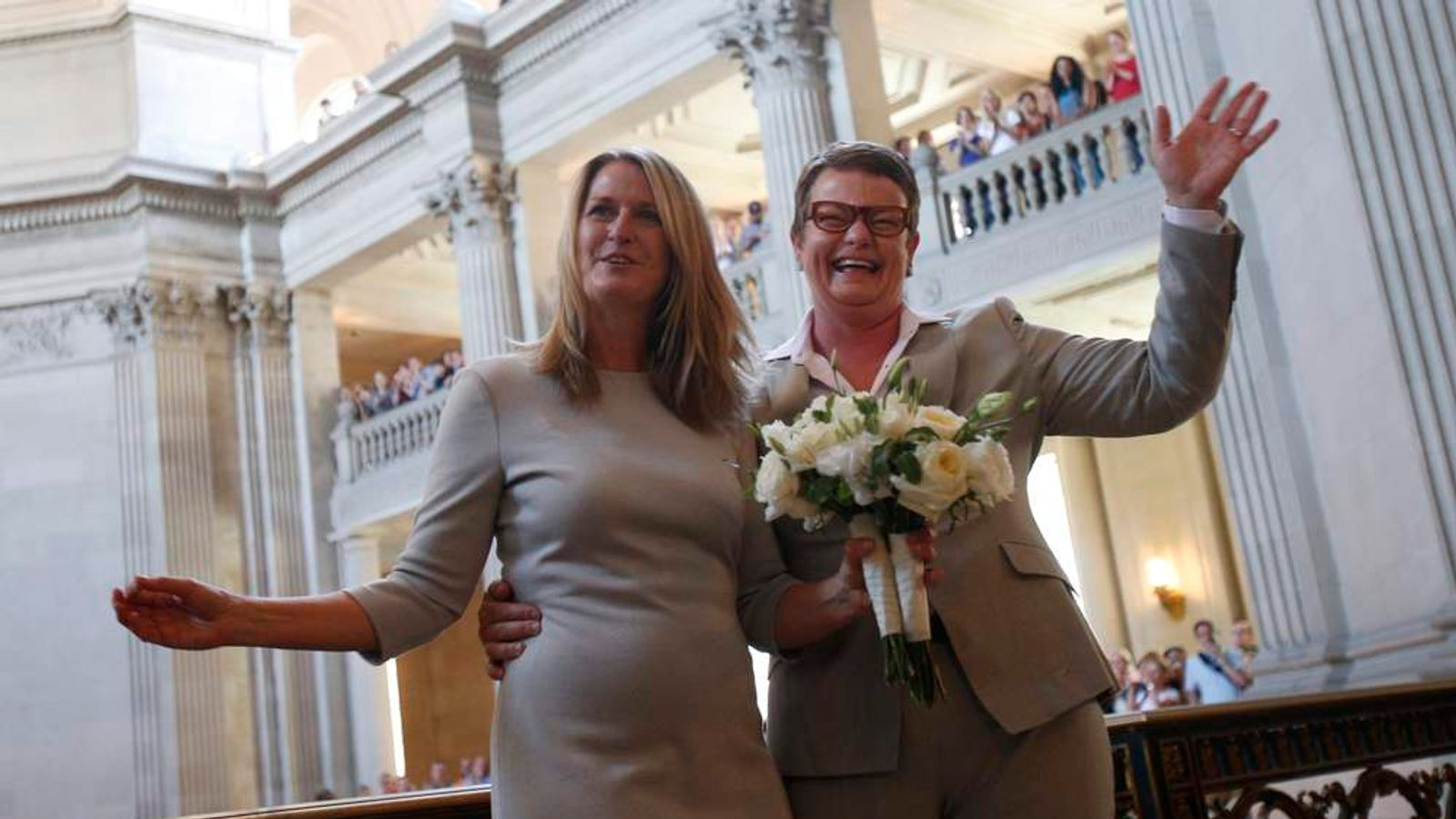 Sandy Stier and Kristin Perry wave after getting married in San Francisco