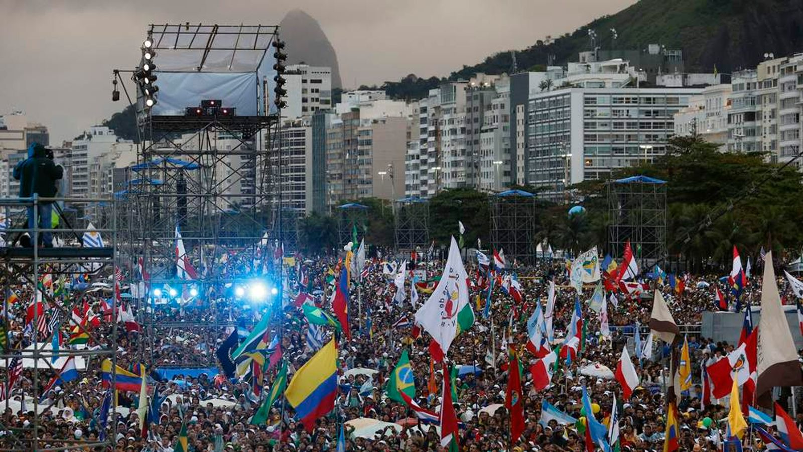 People crowd Copacabana beach as they wait for Pope Francis in Rio de Janeiro
