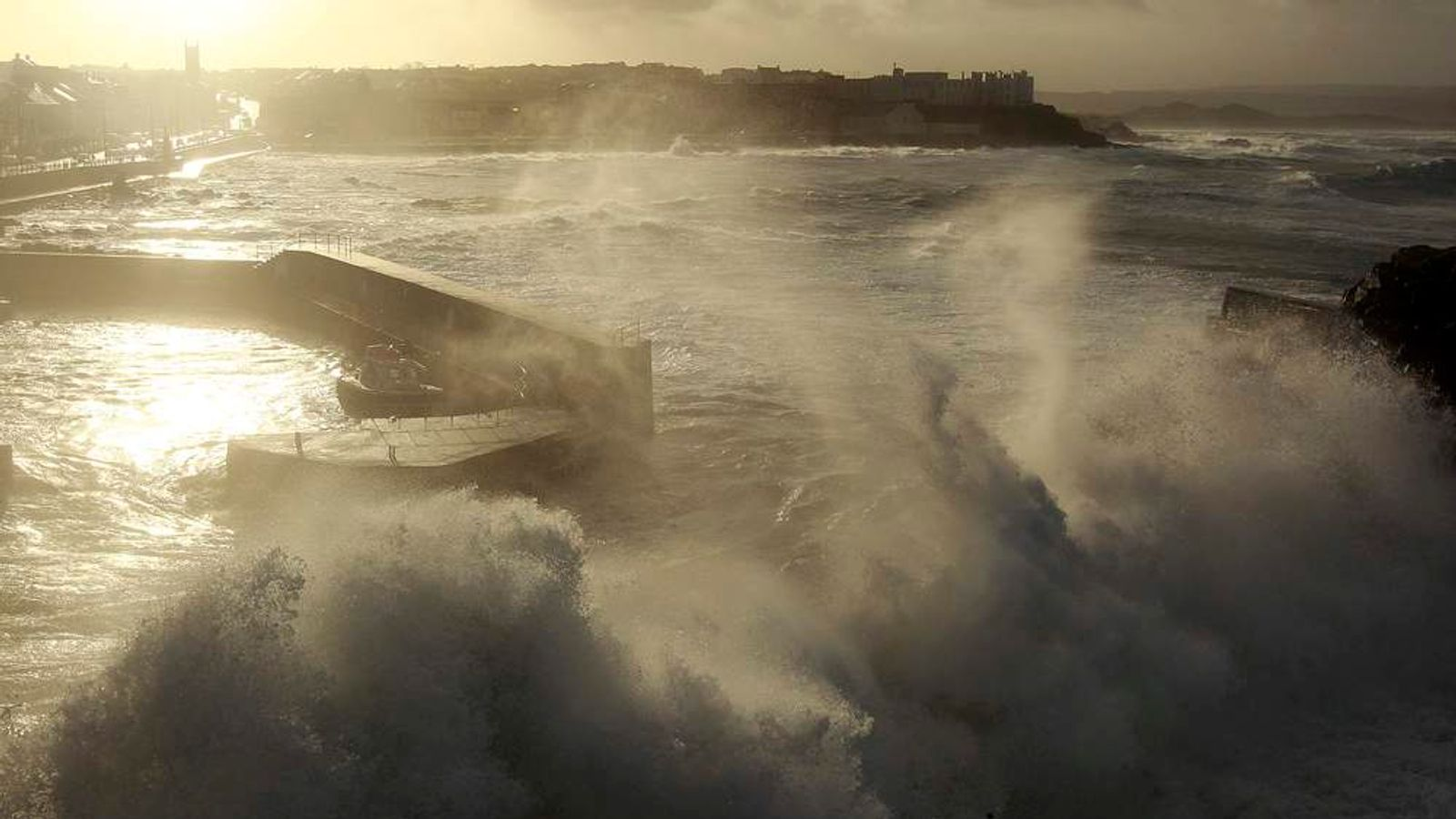 Waves crash against Portstewart Harbour as gale force winds hit the the north Antrim coast in northern Ireland