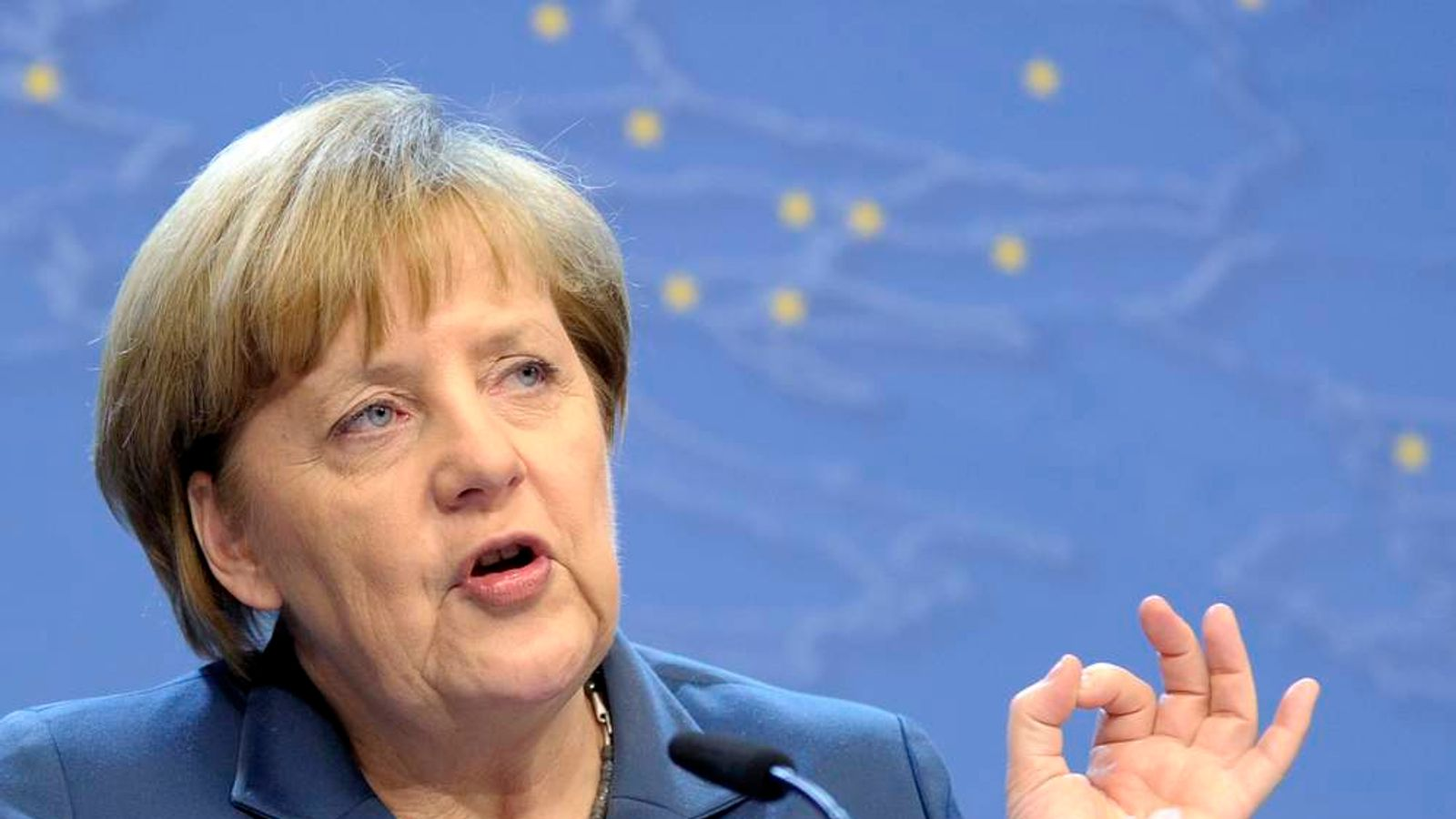 Germany's Chancellor Merkel addresses a news conference during a European Union leaders summit in Brussels