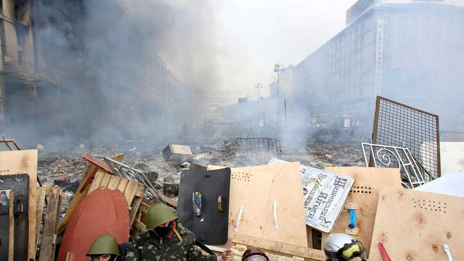 Anti-government protesters rest at a barricade near the site of clashes with Interior Ministry members and riot police in Kiev.