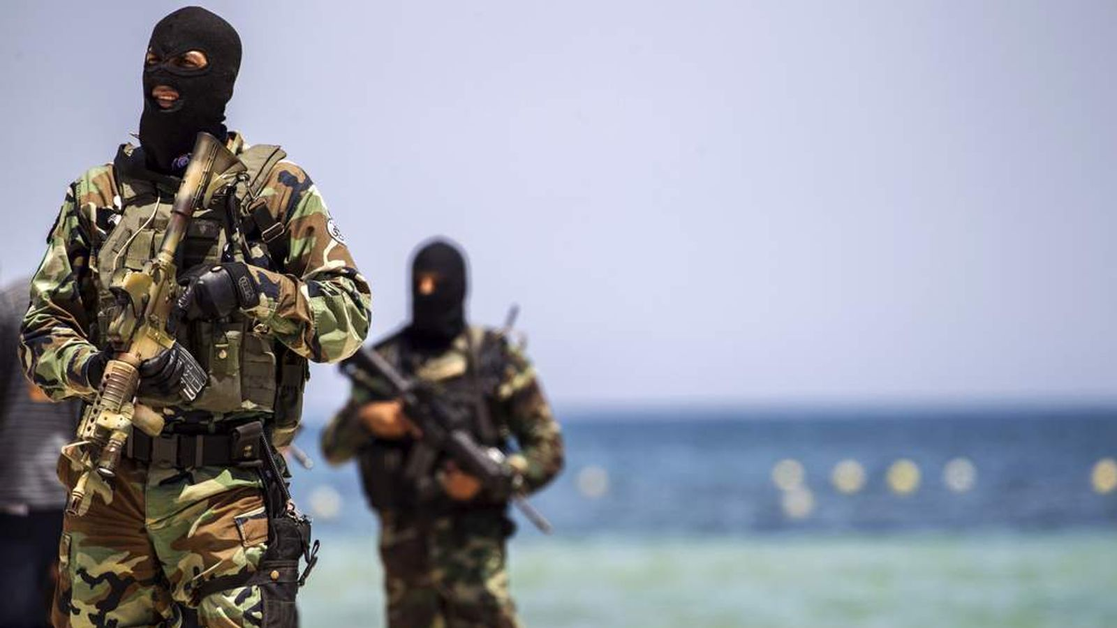 Tunisia's special forces secure the beachside of the Imperial Marhaba resort, while British, French, German and Tunisia's interior minister arrive to pay their tribute in front of a makeshift memorial in Sousse