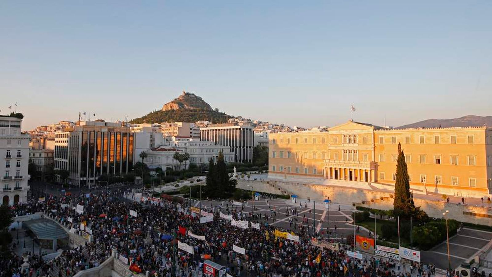 Protests build ahead of key vote on bailout deal austerity measures in Athens.