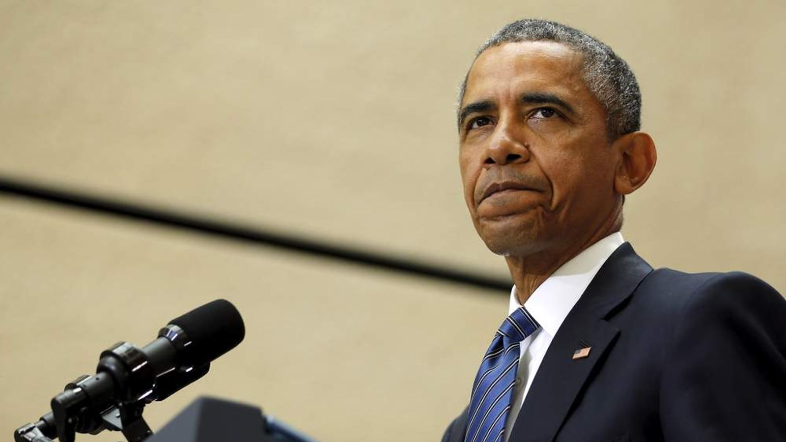 Obama pauses during remarks on a nuclear deal with Iran at American University in Washington