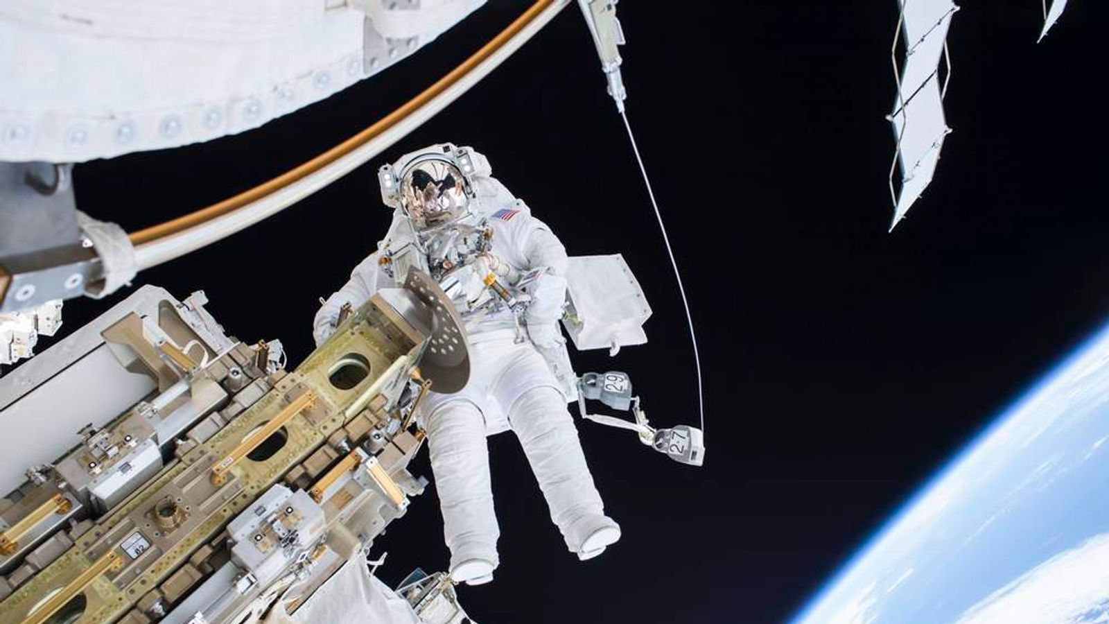 Expedition 46 Flight Engineer Tim Kopra performs a spacewalk outside the International Space Station in this NASA handout photo