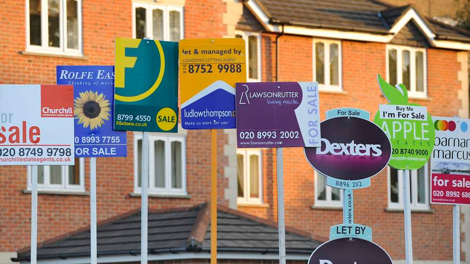 Property sale signs are seen in west London