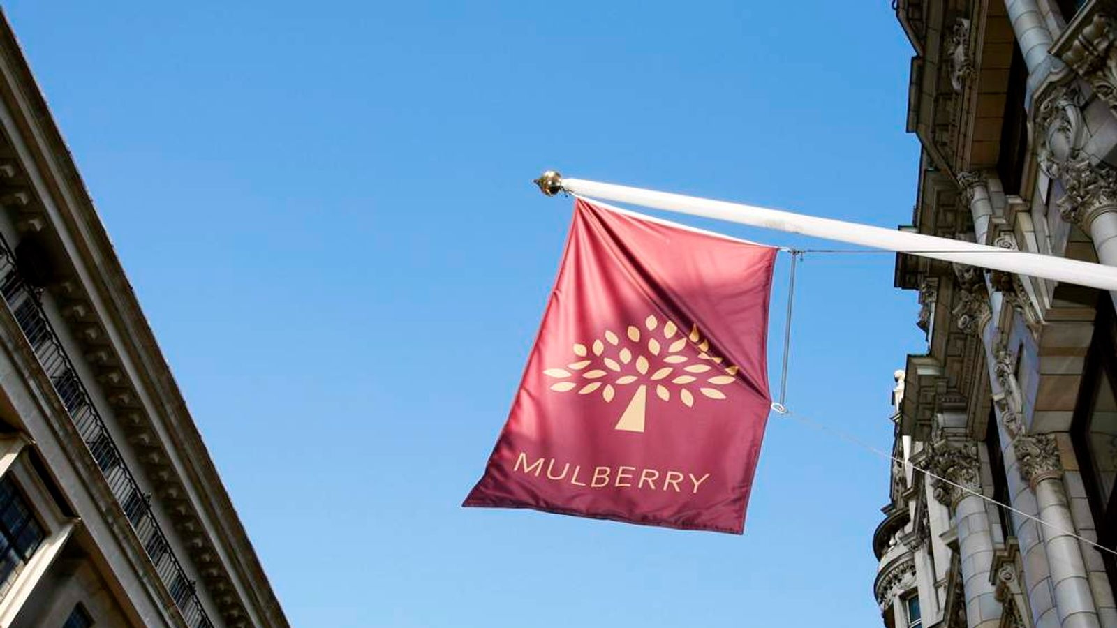 A flag flies above fashion retailer Mulberry's store on New Bond Street in London