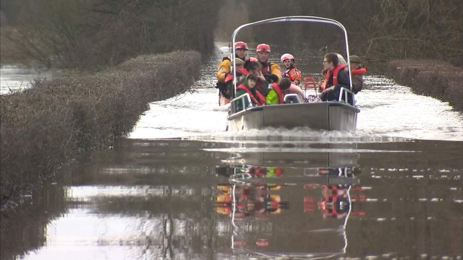 Rescue teams ferry residents across the Somerset Levels