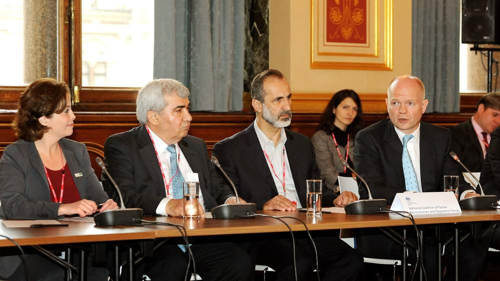 Vice President Suheir Atassi, Riad Seif, President Sheikh Ahmed Mu'az Al-Khatb, and Foreign Secretary William Hague