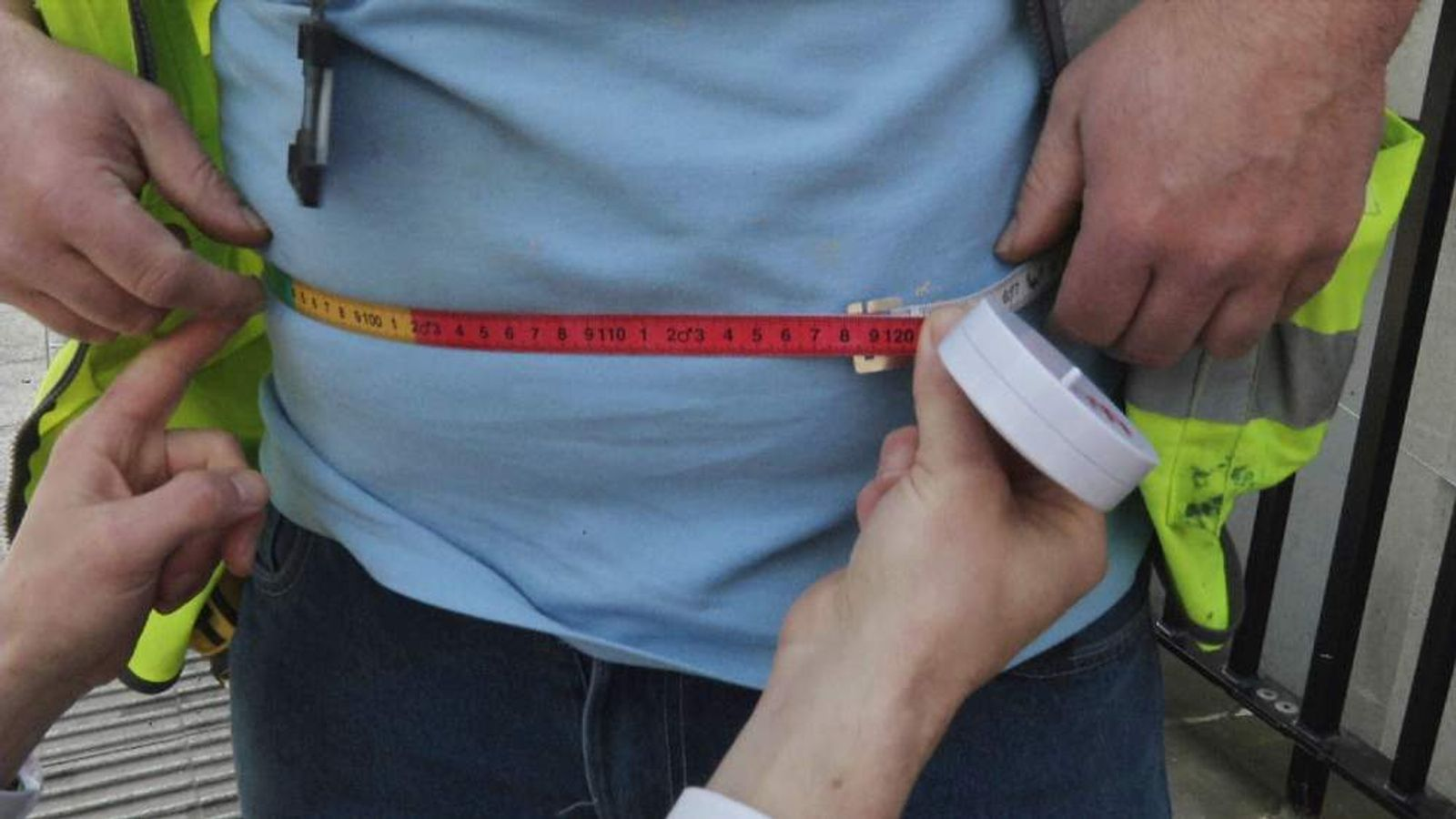 A waistline measured by tape measure