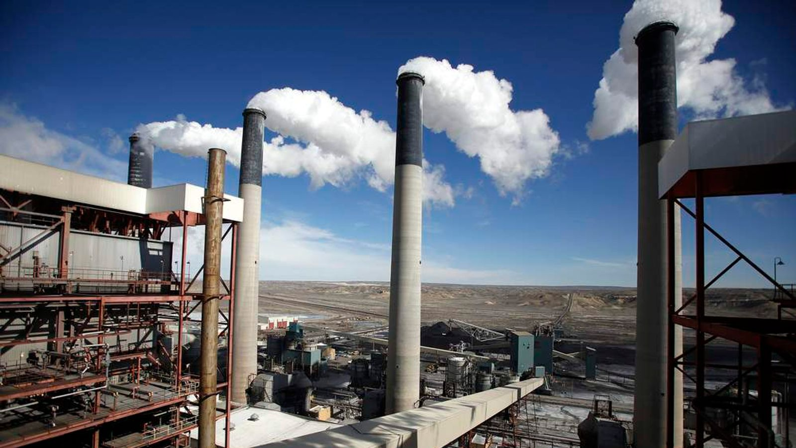 Steam rises from the stakes of the coal fired Jim Bridger Power Plant outside Point of the Rocks, Wyoming
