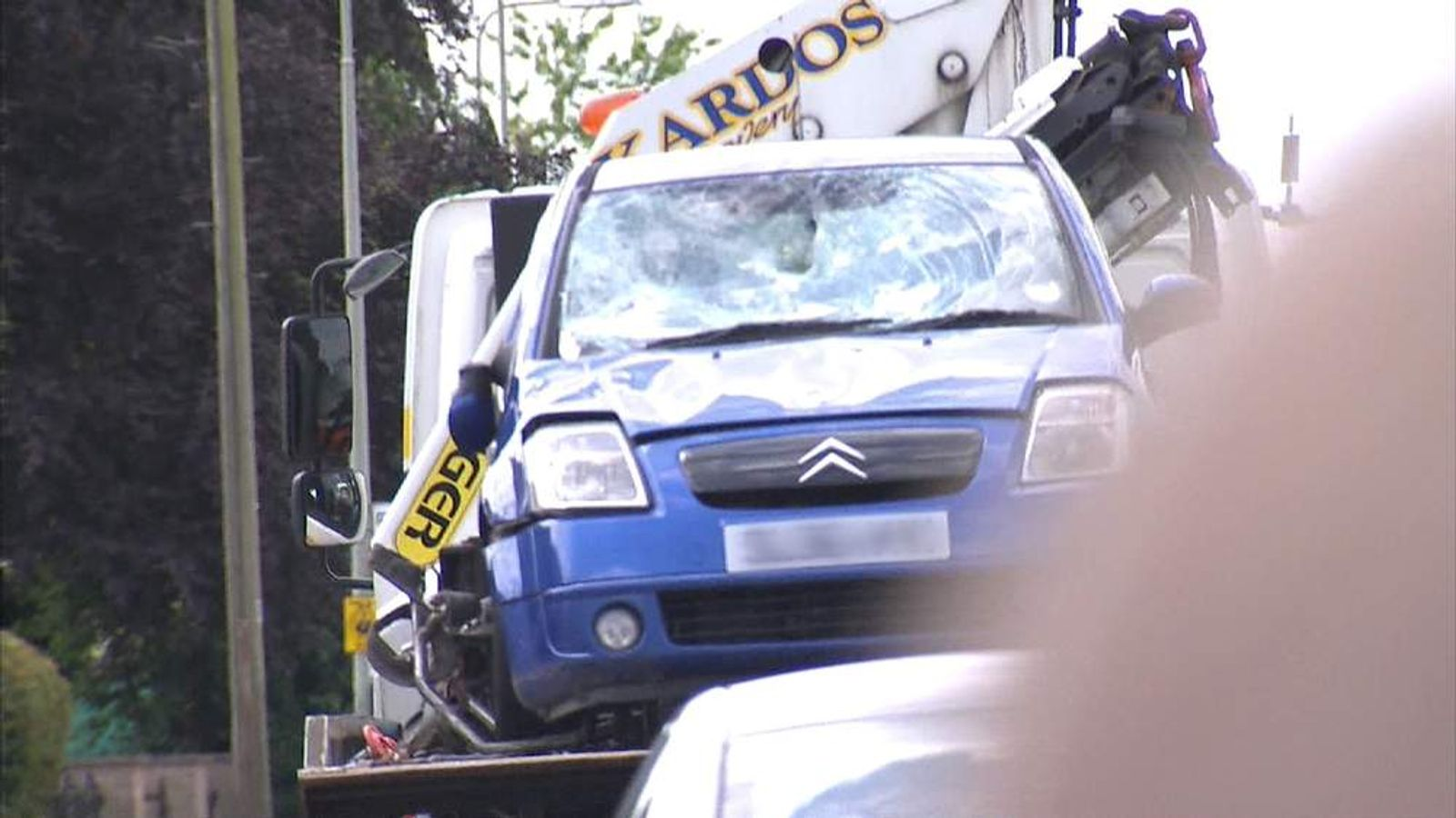 A car involved in a fatal crash in Witney, Oxfordshire, is removed on the back of a low loader