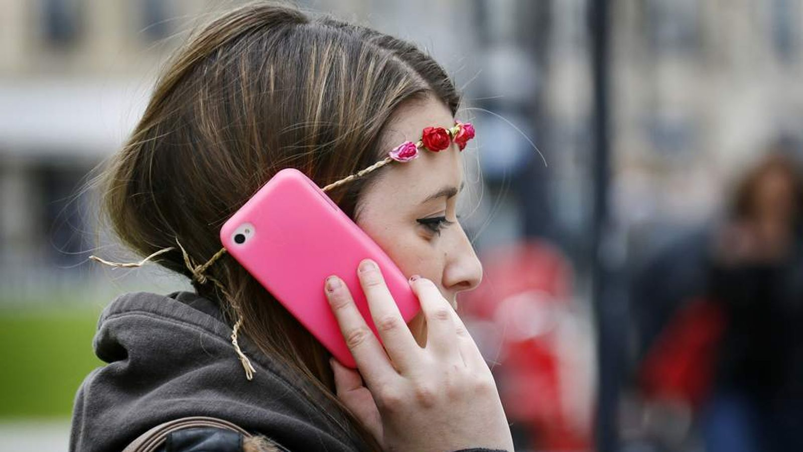 A young woman on a phone in Bordeaux