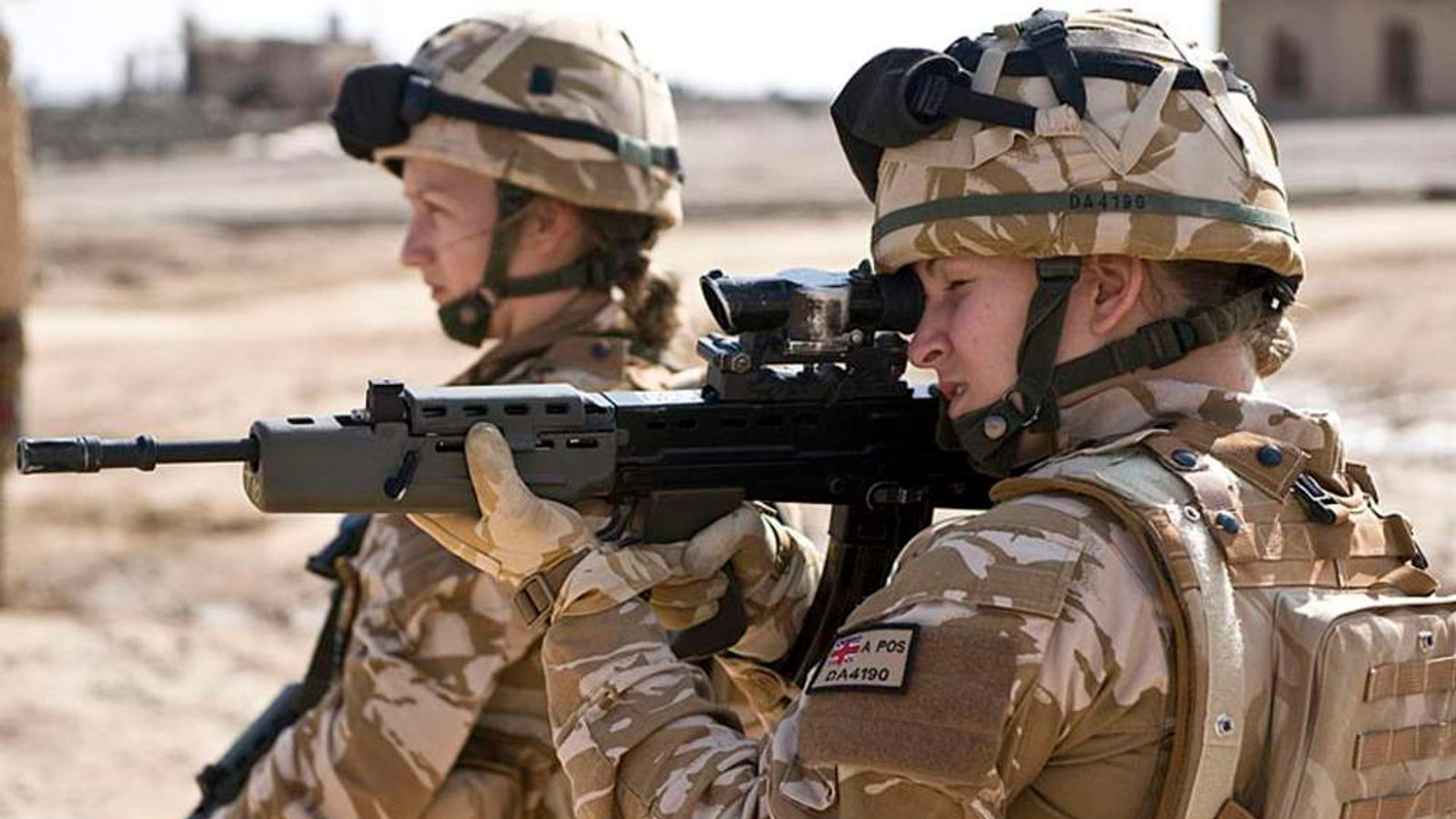 British Female Soldiers On Patrol In Afghanistan