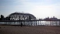 A general view of Eastbourne Pier in East Sussex, as up to 20 firefighters continued to damp down and reach remaining hotspots as dawn broke on fire-ravaged pier.