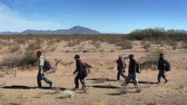 Undocumented Immigrants Cross Into The United States From Mexico