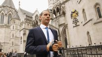 Manchester United footballer Rio Ferdinand leaves the High Court on July 5, 2011 in London
