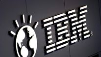 The logo of IBM is seen at their booth p