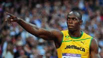 Usain Bolt gestures after winning his 200m semi-final