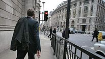 City worker walks past the Bank of England