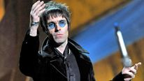 Liam Gallagher throws his microphone into the audience at The Brit Awards 2010