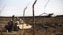Israeli tank in Golan Heights overlooking Syrian village of Breqa