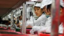 Workers inside a Foxconn factory in the township of Longhua in the southern Guangdong province, China