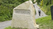 New stone sign at the village of Shitterton in Dorset paid for local residents after thieves kept stealing previous signs
