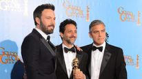 Ben Affleck, George Clooney and Grant Heslov with their award for Argo