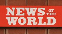 News Of The World sign outside News International building