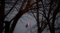 A North Korean flag flies above the North Korean embassy in Beijing