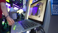 A HP Envy 14 Spectre ultrabook is displayed at the Intel booth during the 2012 International Consumer Electronics Show