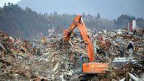 Heavy machinery tackles the tsunami devastation in Rikuzentakata, Japan, March 2012