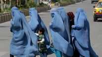 Group of burqa-clad Afghan women