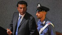Costa Concordia's captain Francesco Schettino speaks with a policeman