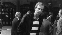 Former Monty Python star Graham Chapman does a silly walk during a sponsored event, 1980