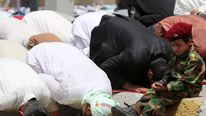 Muslim worshipers, loyal to Shiite cleric Moqtada al-Sadr, performing the Friday prayer on June 20, 2014 in the mainly Shiite Sadr City district in Baghdad.